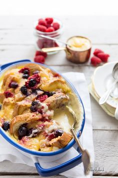 This Raspberry Lemon Curd Bread and Butter pudding. Brioche soaked with custard and baked with raspberries, blueberries and lemon curd. The ultimate dessert