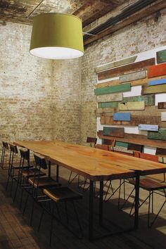 Greenpoint, Brooklyn Warehouse Office Conference Room.  Wood Slab Conference Table, Painted Brick Walls, Reclaimed wood paneling wall design feature, chartreuse pendant, original wood flooring.