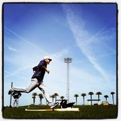 Detroit Tigers outfielder Andy Dirks runs a base running drill at the Tigers' spring training complex in Lakeland.