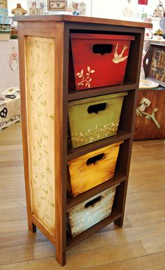 Put on furniture-looking drawers...or make the baskets part of the decor...