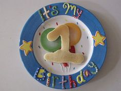 """Made one for Sunshine's GOTCHA DAY at a local pottery painting place! Creating the tradition that we have pancakes on her gotcha day in the """"years you've been home"""" numeral."""