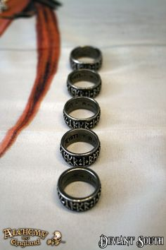 Alchemy Gothic AG-R173 Runeband  A convex, pewter rune-band ring with deep-cut runic letters.