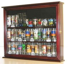 This solid wood display case would be a great way to display your Shot Glass/Mini-Liquor collections. Black felt background to create a lovely display. Brass hinges, door latches, and wall brackets to hang (wall mounted). Can also stand on top of table. Glass door cover to protect from dust and... more details available at https://furniture.bestselleroutlets.com/accent-furniture/display-curio-cabinets/product-review-for-wall-mounted-curio-cabinet-sports-shot-glass-display-cas