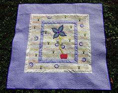 """A FLOWER FOR YOU""  Machine Pieced, Machine Applique, Trapunto, Free Motion Quilting.  60""X 60""  Quilts by Marisela original design.   With lots of love to my aunt Maru and my uncle Tim.  www.quiltsbymarisela.com"