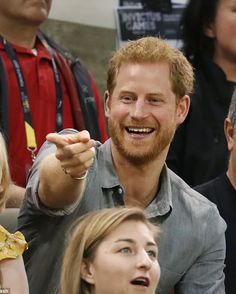 Prince Harry applauds competitors taking part in the recumbent cycling race (R) Prince Harry, arrived at High Park to watch the recum...