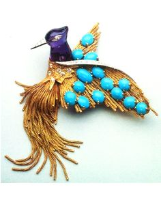 A GOLD AND GEM-SET BIRD BROOCH, BY STERLE