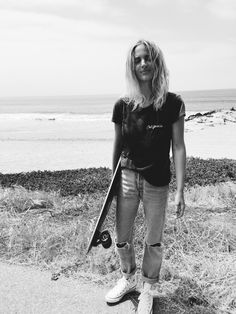 BRANDY MELVILLE  california top (similar here) LEVIS vintage 501jeans(orhere) ARBOR longboard CONVERSE  chucks photography by F. Flatau& me (still life) _____ _____ Longboarding withbae in Malibu. x
