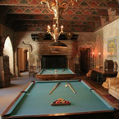 The Billiard Room was a popular spot, where guests could relax and play both billiards and pool. This baroque game room is decorated with a variety of gaming themes, but it also boasts a 15th century Spanish ceiling painted with scenes of courtly life, in addition to a Flemish tapestry from 1500.