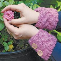 Inspired by the design of an Irish rose garden, these wrist warmers are an easy pattern that can be a first project for a knitter.