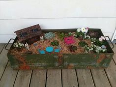 Made a fairy garden out of an army ammo box.