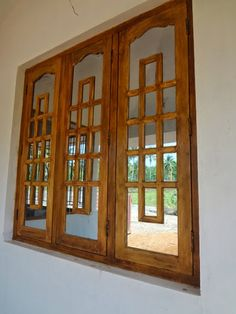 Window Is a vital part of residential buildings. Aside from being a medium for air circulation and channeling light, windows also make the homes we live more comfortable and humane. Indian Window Design, Window Grill Design Modern, House Window Design, Door And Window Design, Wooden Main Door Design, Pooja Room Door Design, Door Design Interior, House Front Design, Wooden Window Frames