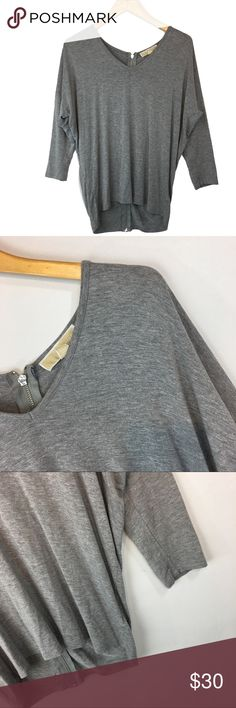 """Michael Kors grey Dolman size medium top **** IF YOU THINK OUR AFFORDABLE PRICES ARE TOO HIGH FOR YOU, MAKE A REASONABLE OFFER ON ANY OF THE ITEMS IN OUR STORE AND WE MAY ACCEPT IT****     - Size: medium  - Material: rayon/ spandex  - Condition: EXCELLENT, like new  - Color: grey  - Pockets: n/a  - Lined: n/a - Closure: zipper  - Pair with:    *Measurements:    Length: 25.5""""   * The more you buy the more you save. Feel free to ask any questions. Thank you for stopping by. * Michael Kors Tops…"""