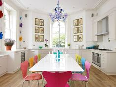 WF - This dining area is brought to life with these vibrant chairs and colourful accessories