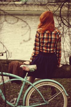 Love this. Super copper hair. Plaid shirt. Skirt. Bike. Everything.