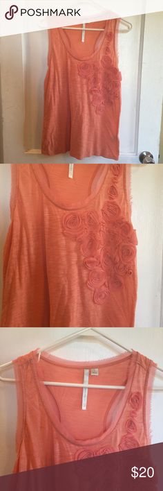 LC Racerback Tank This tank is a creamy Coral tone and boasts romantic flowers on the front. The ends of the collar and arms have detailed edging. In like new condition and no flaws. Price is negotiable ☺️ LC Lauren Conrad Tops Tank Tops