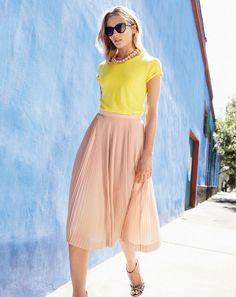 J.Crew women's short-sleeve painter T-shirt, micro-pleated midi skirt, Ryan sunglasses, teardrop crystal necklace and printed multi-strap sandals.