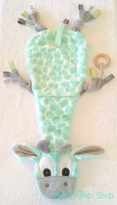 Security Blanket Lovey ♥Each friend is hand crafted and designed by me. Handmade with Love to perfection and made of high quality minky soft fabric materials. So soft and cuddly neutral Giraffe baby blanket handmade by me, made of very soft minky fabric with batting (padding) inside. Really soft and cuddly made for babies or toddlers. The belly, arms, legs, and ears have a cute giraffe print cuddle flannel with neutral colors. Also, comes with a wooden organic ring. Ring comes off by a…