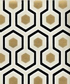 Geometric patterned wallpaper with a touch of gold.