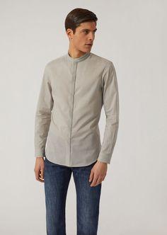b19b9e47e Fine materials and design for this Cotton Canvas Shirt by Emporio Armani  Men. Take a