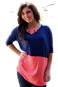 Dolman fit tunic top with colorblocks. Taylor is wearing a size Small.