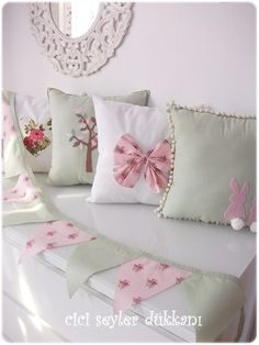 Sweet pillow cushions and bunting by cicişeylerdükkanı, via Flickr. Love the soft colours!
