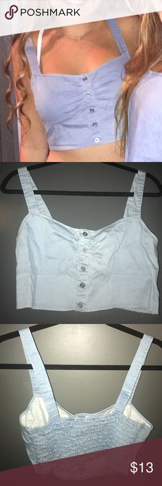 Denim Bustier Crop Top Only worn twice. The back has great stretch from ruched  detail (as pictured) and really flatters a wide range of sizes! Made by Kirra but originally purchased from PacSun! I also have a similar crop top with a bandana tie up back in my closet! A bra is being worn in the photo because we were at a yoga themed party before then going to a hoe down themed party, lol! Bra isn't necessary however a strapless bra does hide nicely under this bustier! BETTER PICTURES COMING…