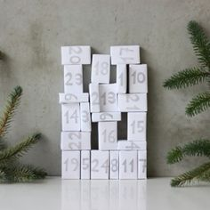 Put sweets in matchboxes and wrap them in paper stamped with numbers!