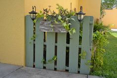 Pallet fence or to surround an A/C unit, With planter box and solar lights!