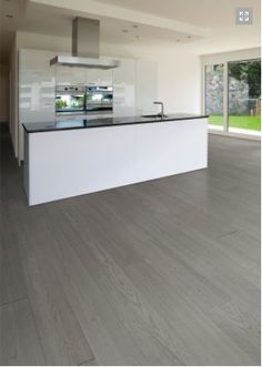 Grey flooring with white unit and black work top.