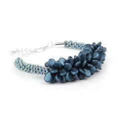 Learn how to make this Blue Coral Kumihimo Bracelet using our new Preciosa Czech glass pip beads in frosted navy. For this project you will need a kumihimo disk and you may want to use bobbins to make the braiding easier and tidier.