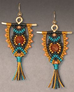 """Owl Earrings Kit - Black / Teal / Gold    Maybe you'll see a shape that resembles a owl in this design or maybe you won't - in any case these unique earrings are my most popular design. Cord colors are black, teal, and gold. There is a carnelian colored center bead with gold matte and peach seed beads. Gold-filled wire and shaped brass finding. 1.75""""L X 1""""W (Earring wire adds another .5"""" in length).    Skill Level - Intermediate to Advanced.    Price 30.00"""