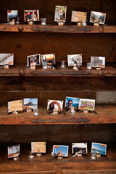 """For this """"travel"""" themed wedding, the couple displayed a wall of postcards from different trips and pictures of them at each location. Photo by Ashley B. #weddingphotographersminnesota"""