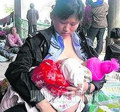 http://write-on.hubpages.com/hub/Police-Woman-in-China-Breast-Feeds-Helpless-Babies-Following-Devastating-Earthquake