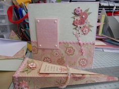 Card and matching gift box - K&Co Cardstock on bottom of card.  Gift box from a K&Co book of die cut bags, floral decoration on card from the book too.