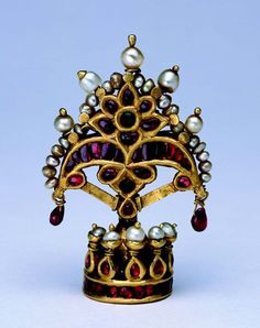 North or Central India | Gold crown in two parts the image of a deity set with rubies, emeralds, and pearls | ca. early 19th century | Susan L. Beningson Collection