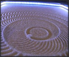 I WANT IT SO MUCH! It's a Zen Table that creates all these awesome patterns on it's own.