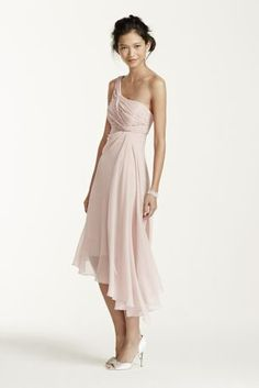 Timeless, elegant and chic, this short crinkle chiffon dress will be your bridesmaids new go to staple dress long after the wedding reception!  One shoulder neckline features ultra-feminine ruched bust.  Soft twist cascade bodice and asymmetrical hemline gives this dress a whimsical feel.  Fully lined. Back zip. Imported polyester.  To protect your dress, try our Non Woven Garment Bag.  Sizes and colors are available in limited stores and with limited availability.Also available in Extra