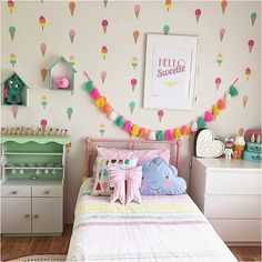 Sherbert-colored girl's room with ice cream theme