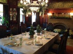 Clayton's dining room sparkles with green stemware and Limoges soup plates with a snowflake motif.