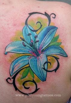 Lily tattoo...I don't like the tribal-esque viney things, but I'm digging the colors & size.