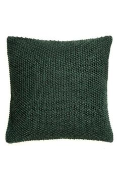 Moss-knit cushion cover: Moss-knit cushion cover with a woven cotton backing and a concealed zip.