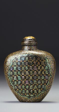 A MOTHER-OF-PEARL INLAID BLACK AND BROWN LACQUER 'SHIELD' SNUFF BOTTLE<br>JAPAN, LATE 19TH CENTURY | lot | Sotheby's