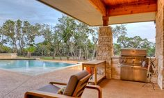 rim rock custom home | Design Visions of Austin Built-in grill