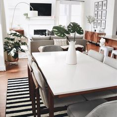 Begin by picking a chandelier or other low-hanging lights to mainly illuminate your dining table. Remember to keep a area between the bottom of the light and the table. White Dining Table, Modern Dining Table, Dining Table In Kitchen, Dining Table Chairs, Dining Area, West Elm Dining Table, Mid Century Dining Table, Small Dining, Arm Chairs