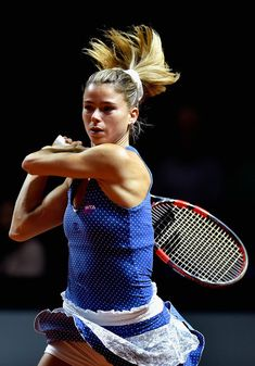 Camila Giorgi of Italy plays a backhand in her match against Annika Beck of Germany during Day 2 of the Porsche Tennis Grand Prix at Porsche-Arena on April 2016 in Stuttgart, Germany. (Photo by Dennis Grombkowski/Bongarts/Getty Images) Camila Giorgi, Grand Prix, Porsche, Tennis Players Female, Tennis Racket, Camilla, Pretty Girls, Stuttgart Germany, Sporty