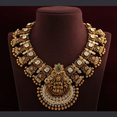 New age temple jewellery necklace royal looking Lakshmi necklace in antique finish 22 carat gold embellished with polki diamonds, small pearls and gold balls. Indian Jewelry Sets, Indian Wedding Jewelry, India Jewelry, Antique Jewellery Designs, Gold Jewellery Design, Handmade Jewellery, Antique Jewelry, Gold Temple Jewellery, Gold Bridal Jewellery