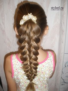cute intricate braid.. looks like they just overlap one another repeatedly to get this effect, not really braiding afterall