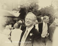 Father of the bride photographed in Chelsea Physic Gardens - black and white