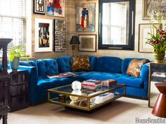In this Miles Redd-designed family room, a sectional from Christie's — covered in a rich blue cotton velvet by Schumacher — lives underneath a selection of abstract artwork hung atop a Nobilis Chene faux-bois paper. See the full house tour here. My Living Room, Living Spaces, Small Living, Blue Couches, Blue Sectional, Tufted Sectional, Green Sofa, Family Room Design, Beautiful Homes
