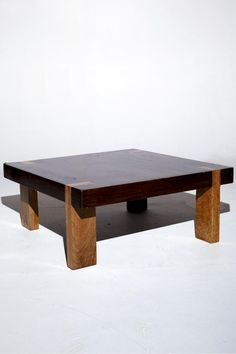 mixed wood leg coffee table